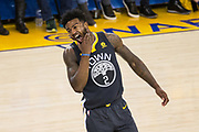 Golden State Warriors center Jordan Bell (2) reacts to getting hit in the jaw by the Houston Rockets during Game 4 of the Western Conference Finals at Oracle Arena in Oakland, Calif., on May 22, 2018. (Stan Olszewski/Special to S.F. Examiner)