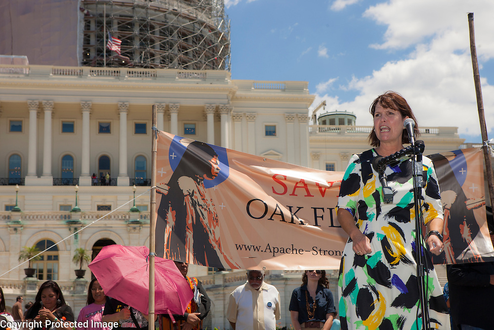 "Representative Betty McCollum (D-MN-4) speaks to members of the San Carlos Apache Tribe and their supporters in front of the United States Capitol to protest the transfer of Apache land to a private Australian-British mining corporation.  In December 2014, a rider to the National Defense Authorization Act handed over Oak Flat to a foreign-owned company looking to mine copper.  The Apache are currently ""occupying"" Oak Flat, and travelled to D.C. to protest the action.  In response, Rep. Raul Grijalva (D-AZ), proposed the Save Oak Flat Act (H.R. 2811) in June, 2015 to repeal the land exchange.  Rep. McCollum is a co-sponsor of that bill.  John Boal Photography"
