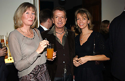 Left to right, LADY HESKETH, NICKY HASLAM and SABRINA GUINNESS at a party to celebrate the 4th anniversary of Quintessentially held at 11 Grosvenor Place, London  SW1 on 14th December 2004.<br /><br />NON EXCLUSIVE - WORLD RIGHTS