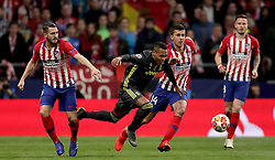 Juventus'  Alex Sandro, (centre) battles for possession of the ball with Atletico Madrid's Koke, (left)