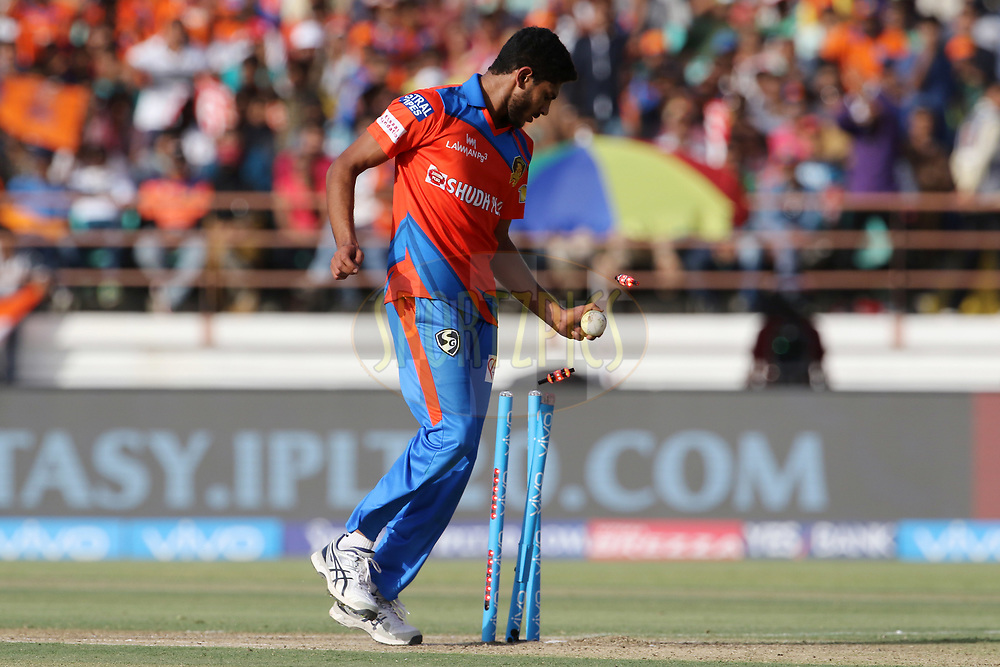Basil Thampy of the Gujarat Lions run outs Wriddhiman Saha of Kings XI Punjab during the match 26 of the Vivo 2017 Indian Premier League between the Gujarat Lions and the Kings XI Punjab held at the Saurashtra Cricket Association Stadium in Rajkot, India on the 23rd April 2017<br /> <br /> Photo by Vipin Pawar - Sportzpics - IPL