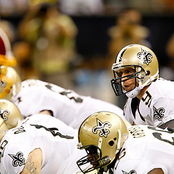 September 9, 2012; New Orleans, LA, USA; New Orleans Saints quarterback Drew Brees (9) at the line during the first half of a game against the Washington Redskins at the Mercedes-Benz Superdome. Mandatory Credit: Derick E. Hingle-US PRESSWIRE