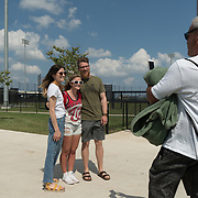 WEST PALM BEACH, FL MARCH 20, 2018:Washington Nationals closer Sean Doolittle and wife Eireann Dolan pose for a photo with fan  Camryn Hall, 18, as dad Kerry Hall handles the smart phone at FITTEAM Ballpark of the Palm Beaches on March 20, 2018. The couple, married a year ago, is very involved in charitable organizations and are fan favorites. (Photo by Angel Valentin-For The Washington Post )