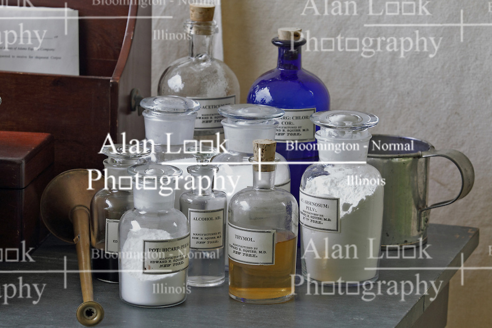 21 July 2013:   Embalming tools and bottles of supplies displayed on a table in the display of Dr. Benjamin Lyford near the 10th Illinois Volunteer Calvary Regiment encampment of Civil War Days at Ames Library on the campus of Illinois Wesleyan University.