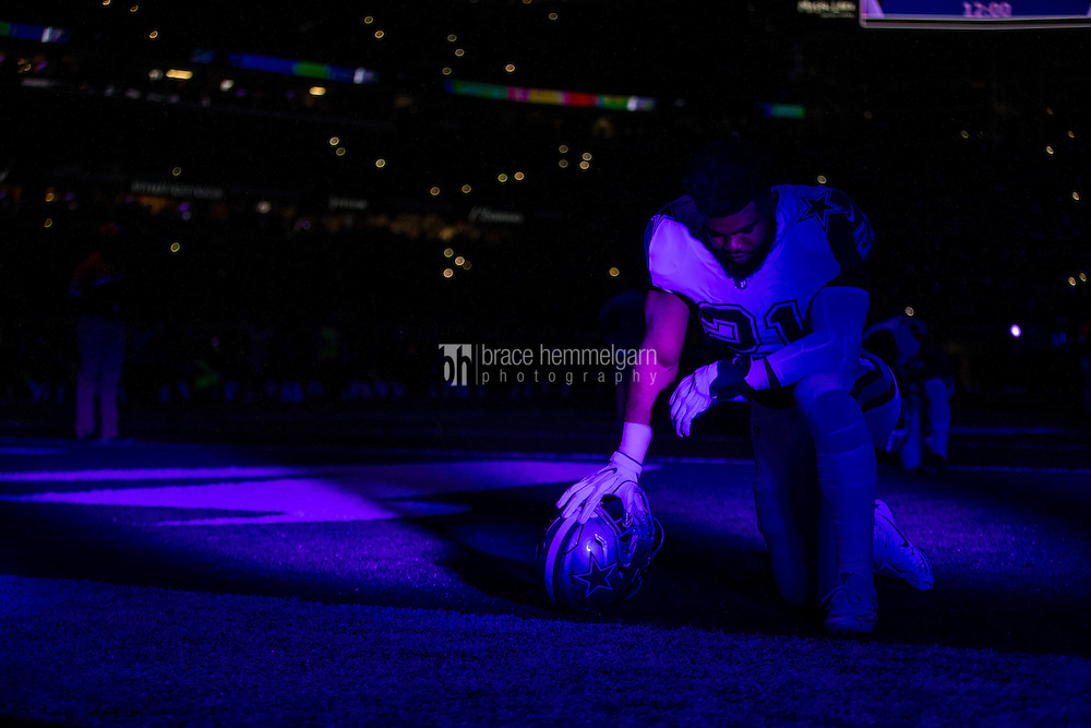 Dec 1, 2016; Minneapolis, MN, USA; Dallas Cowboys running back Ezekiel Elliott (21) kneels prior to the game between the Dallas Cowboys and Minnesota Vikings at U.S. Bank Stadium. The Cowboys defeated the Vikings 17-15. Mandatory Credit: Brace Hemmelgarn-USA TODAY Sports