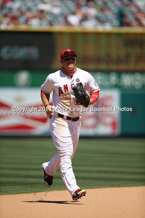 ANAHEIM, CA - JULY 24:  Mike Trout #27 of the Los Angeles Angels of Anaheim jogs back to the dugout during the game against the Minnesota Twins on Wednesday, July 24, 2013 at Angel Stadium in Anaheim, California. The Angels won the game in a 1-0 shutout. (Photo by Paul Spinelli/MLB Photos via Getty Images) *** Local Caption *** Mike Trout