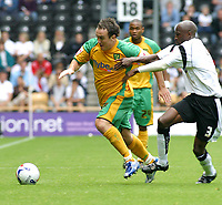 Photo: Dave Linney.<br />Derby County v Norwich City. Coca Cola Championship. 19/08/2006.Norwich'S Lee Croft(L) evades the challenge of  Mo Camara