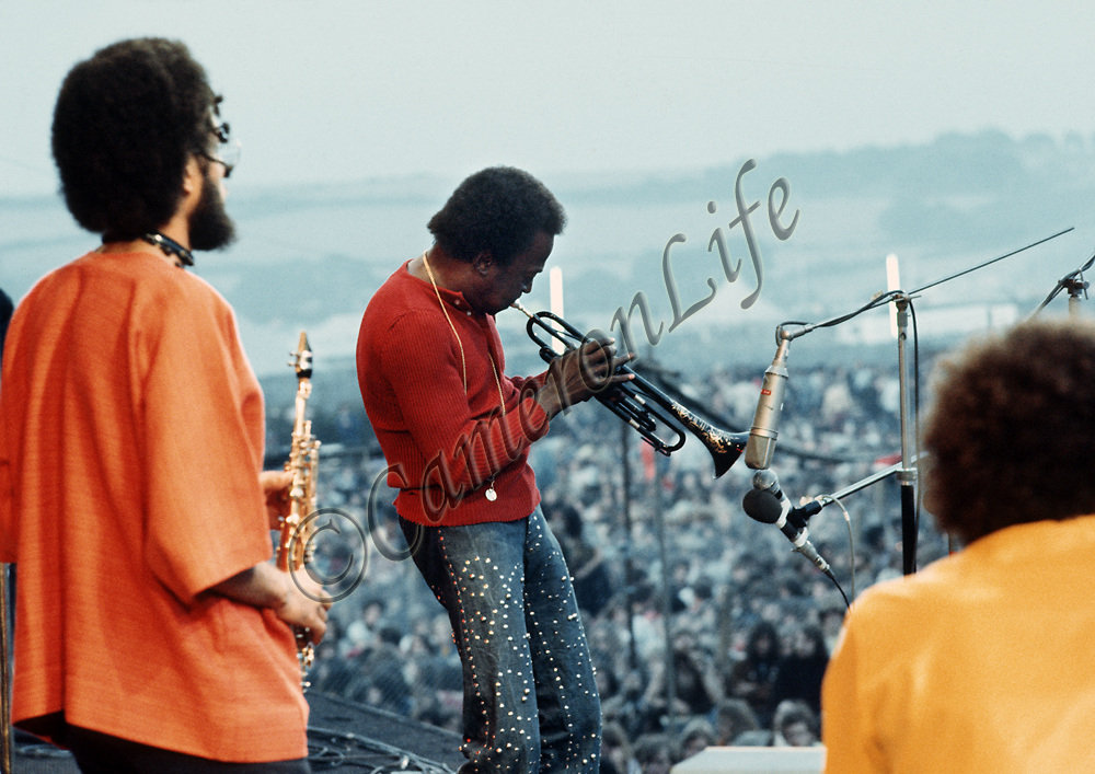 "Miles Davis - on stage.- .When asked on stage what the piece of music he was playing was called, Miles replied ""Call it anything"". The title stuck and to this day it became the unofficial title of that set at the festival. His performance was mostly improvised, and rather like an abstract and pleasing painting that went on for a very long time. This era was known as Miles'Electric Period."