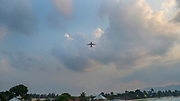 A plane is departing from the near by airport next to the Big Buddha port, Koh Samui, Thailand