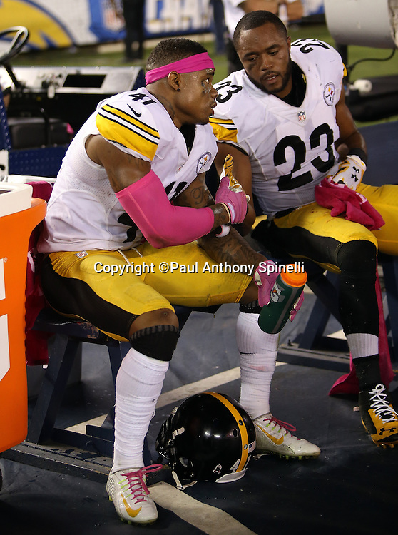 Pittsburgh Steelers cornerback Antwon Blake (41) is congratulated by Steelers free safety Mike Mitchell (23) as the pair of Steelers ride the bench after Blake returns an interception 70 yards for a touchdown and a 10-7 Steelers third quarter lead during the 2015 NFL week 5 regular season football game against the San Diego Chargers on Monday, Oct. 12, 2015 in San Diego. The Steelers won the game 24-20. (©Paul Anthony Spinelli)
