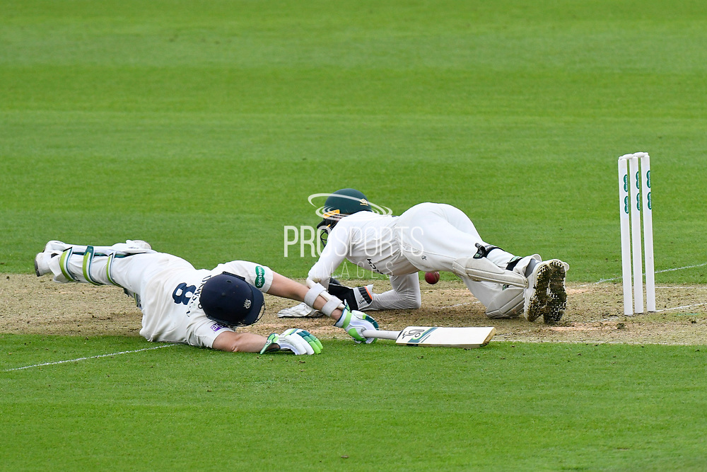 Liam Dawson of Hampshire dives back across his crease to prevent being run out during the Specsavers County Champ Div 1 match between Hampshire County Cricket Club and Worcestershire County Cricket Club at the Ageas Bowl, Southampton, United Kingdom on 13 April 2018. Picture by Graham Hunt.