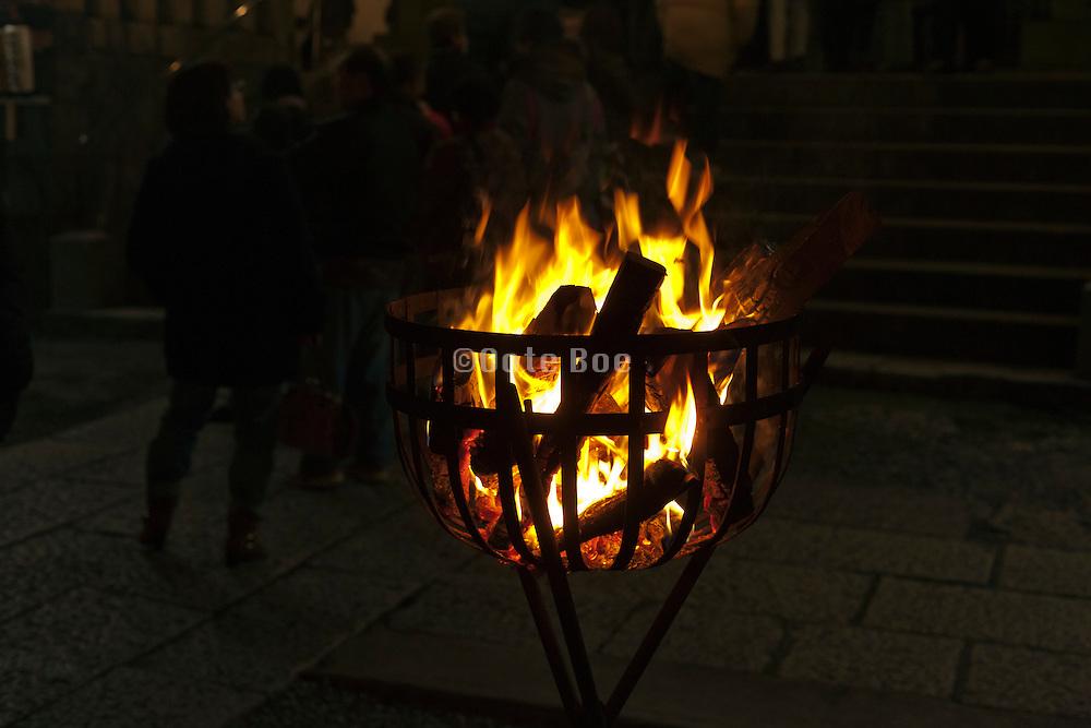 wood fire burning basket Japan, New Year's Eve shrine