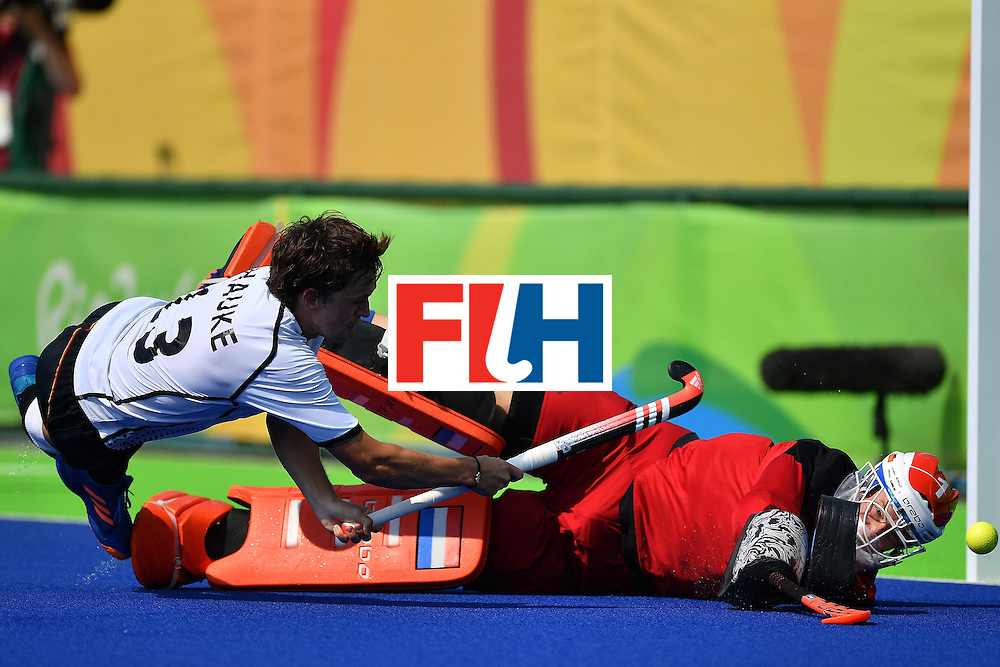 RIO DE JANEIRO, BRAZIL - AUGUST 18:  Goalkeeper of Netherlands Jaap Stockmann tries to save the shot from Tobias Hauke of Germany during the penalty shoot out of the Mens's Bronze medal match between the Netherlands and Germany on Day 13 of the Rio 2016 Olympic games at Olympic Hockey Center on August 18, 2016 in Rio de Janeiro, Brazil.  (Photo by Pascal Le Segretain/Getty Images)