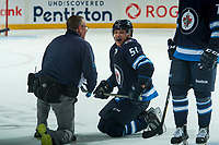 PENTICTON, CANADA - SEPTEMBER 8: Luke Green #51 of Winnipeg Jets received medical attention on the ice against the Vancouver Canucks on September 8, 2017 at the South Okanagan Event Centre in Penticton, British Columbia, Canada.  (Photo by Marissa Baecker/Shoot the Breeze)  *** Local Caption ***
