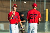 KELOWNA, BC - JULY 17:  Third baseman tosses the ball to pitcher Zach Jacobs #27 of the Kelowna Falcons against the Wenatchee Applesox at Elks Stadium on July 17, 2019 in Kelowna, Canada. (Photo by Marissa Baecker/Shoot the Breeze)