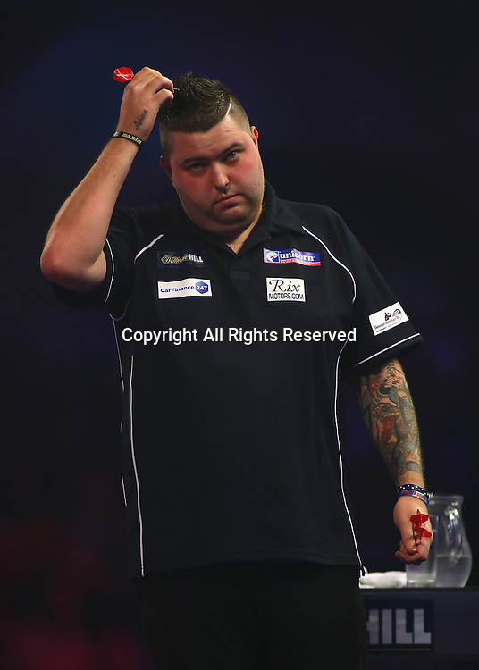23.12.2016. Alexandra Palace, London, England. William Hill PDC World Darts Championship. Michael Smith reacts as he goes behind in the first leg, during his match with Mervyn King
