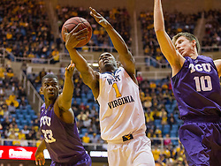 Feb 13, 2016; Morgantown, WV, USA; West Virginia Mountaineers forward Jonathan Holton (1) grabs a rebound during the first half against the TCU Horned Frogs at the WVU Coliseum. Mandatory Credit: Ben Queen-USA TODAY Sports