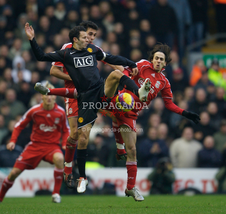 LIVERPOOL, ENGLAND - Sunday, December 16, 2007: Liverpool's Yossi Benayoun and Manchester United's Ryan Giggs during the Premiership match at Anfield. (Photo by David Rawcliffe/Propaganda)