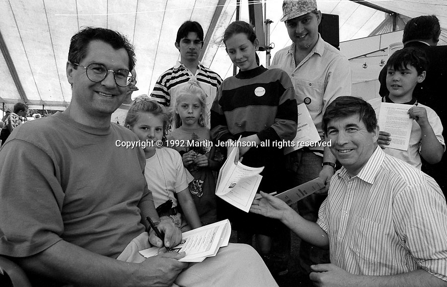 "TV actors from ""The Bill"", Colin Tarrant (Inspector Andrew Munroe}  and Peter Ellis (Chief Supt Charles Brownlow) sign autographs at the 1992 Yorkshire Miners Gala, Barnsley."