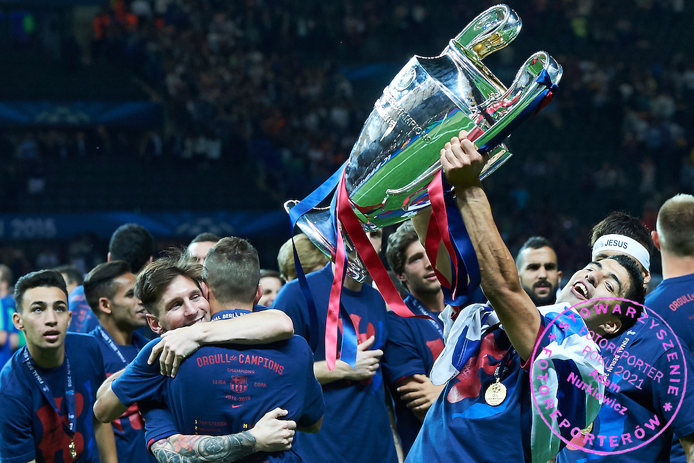 (R) Luis Suarez of FC Barcelona holds the trophy and celebrates victory during the 2014/15 UEFA Champions League Final between Juventus and FC Barcelona at Olympiastadion on June 6, 2015 in Berlin, Germany.<br /> Germany, Berlin, June 6, 2015<br /> <br /> Picture also available in RAW (NEF) or TIFF format on special request.<br /> <br /> For editorial use only. Any commercial or promotional use requires permission.<br /> <br /> Adam Nurkiewicz declares that he has no rights to the image of people at the photographs of his authorship.<br /> <br /> Mandatory credit:<br /> Photo by &copy; Adam Nurkiewicz / Mediasport