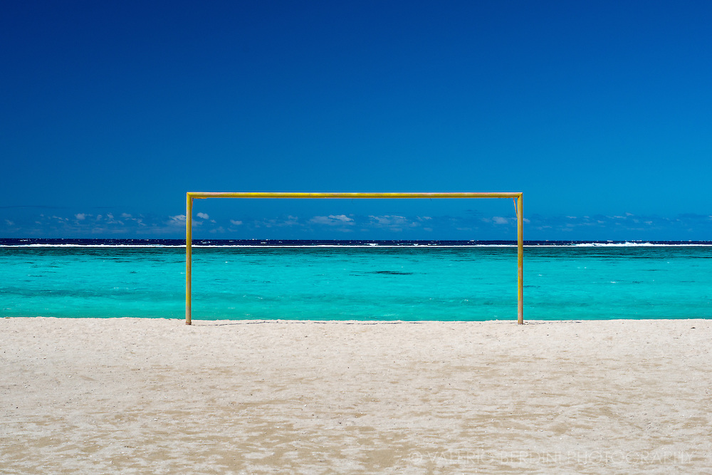 A goal post of a beach football pitch looking over the lagoon of Moorea
