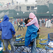 A couple embraced after they had become engaged an hour before in the infield during the 136th running of the Kentucky Derby at Churchill Downs Saturday May 1, 2010. Photo by David Stephenson