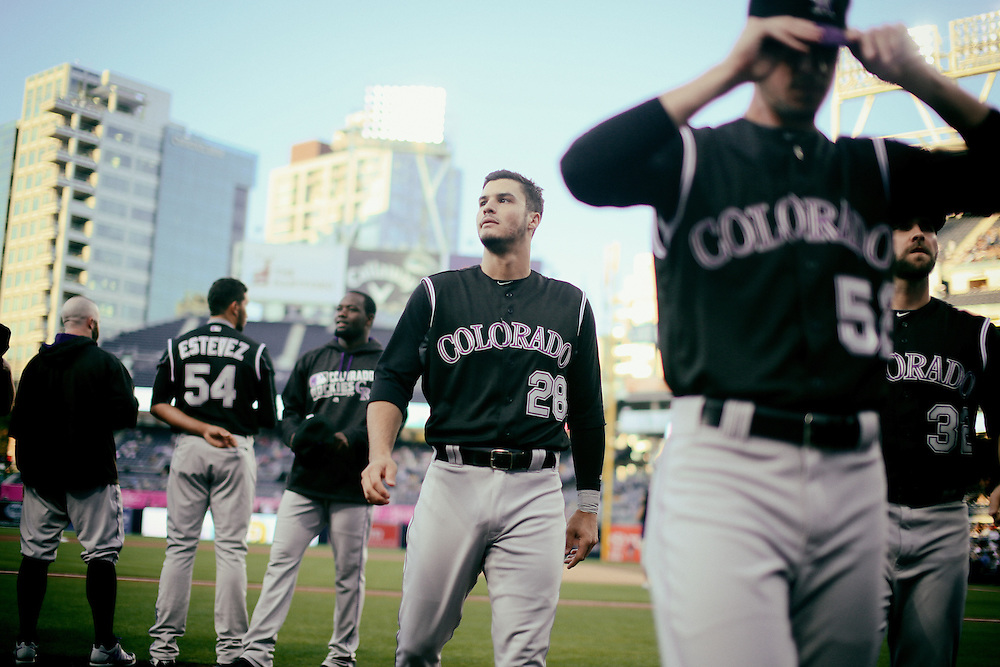 San Diego, CA - JUNE 04:   Nolan Arenado walks off the field with teammates after pre game ceremonies at Petco Park during game with the San Diego Padres San Diego, California.  (Sandy Huffaker for ESPN)