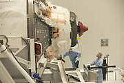 Sterile technicians construct European Space Agency's Automated Transfer Vehicle (ATV) Jules Verne module at Kourou Spaceport.
