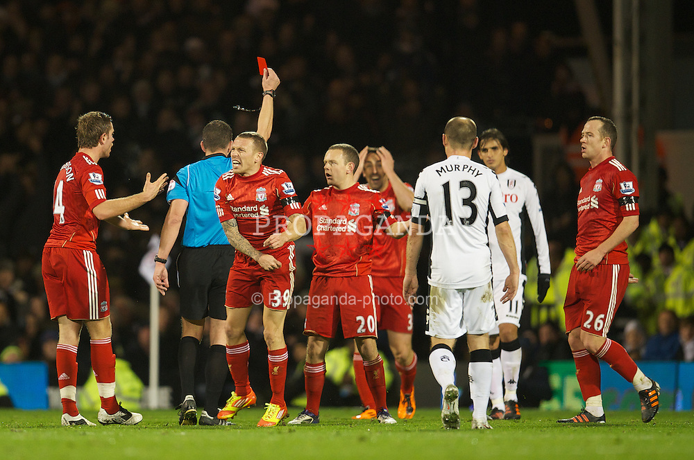 LONDON, ENGLAND - Monday, December 5, 2011: Liverpool's Charlie Adam is shown the red card by referee Kevin Friend, to the amazement of his team-mates during the Premiership match against Fulham at Craven Cottage. (Pic by David Rawcliffe/Propaganda)
