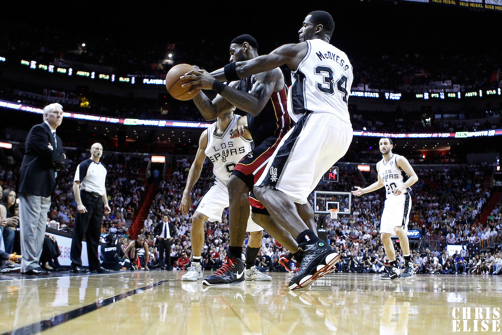 14 March 2011: San Antonio Spurs power forward Antonio McDyess (34) defends on Miami Heat small forward LeBron James (6) during the Miami Heat 110-80 victory over the San Antonio Spurs at the AmericanAirlines Arena, Miami, Florida, USA.