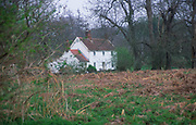 ADD2R2 Remote white country cottage in woods Suffolk England