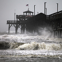 Surf kicks up at the Cherry Grove Fishing Pier as Tropical Storm Florence's winds shifted onshore Friday, Sept. 14, 2018, in North Myrtle Beach. Andrew Knapp/Staff