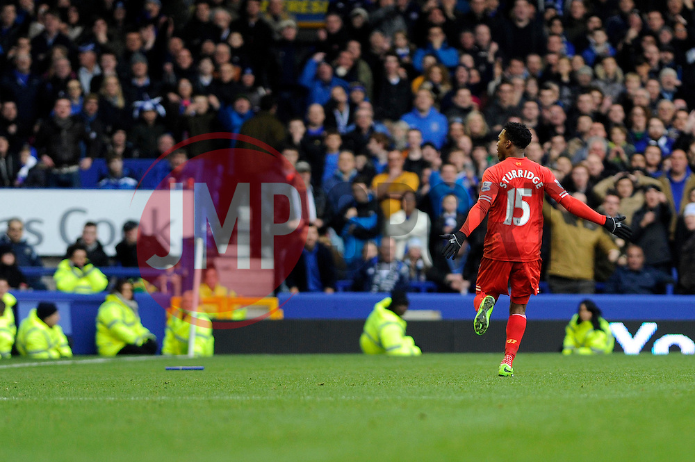 Liverpool's Daniel Sturridge celebrates his goal in front of the home fans - Photo mandatory by-line: Dougie Allward/JMP - Tel: Mobile: 07966 386802 23/11/2013 - SPORT - Football - Liverpool - Merseyside derby - Goodison Park - Everton v Liverpool - Barclays Premier League