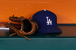 SAN FRANCISCO, CA - MAY 05: General view of a baseball glove and a Los Angeles Dodgers hat in the dugout before the game against the San Francisco Giants at AT&T Park on May 5, 2013 in San Francisco, California. The San Francisco Giants defeated the Los Angeles Dodgers 4-3. (Photo by Jason O. Watson/Getty Images) *** Local Caption ***
