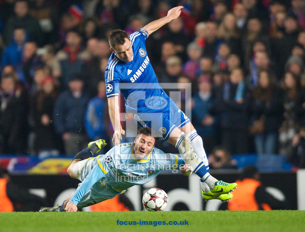 Picture by Alan Stanford/Focus Images Ltd +44 7915 056117<br /> 11/12/2013<br /> John Terry of Chelsea has a coming together with Federico Piovaccari of Steaua Bucharest during the UEFA Champions League match at Stamford Bridge, London.