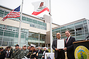 Santa Clara County Supervisor Dave Cortese presents Mayor Jose Esteves with a plaque of Resolution during the Milpitas Memorial Day Ceremony at Veterans Memorial Flag Plaza in Milpitas, California, on May 27, 2013. (Stan Olszewski/SOSKIphoto)