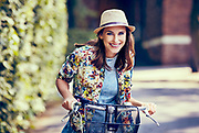 Beautiful woman riding bike in the city
