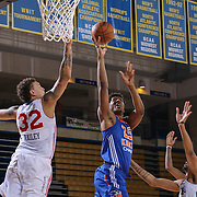 Westchester Knicks Forward DAMIEN INGLIS (25) drives towards the basket as Delaware 87ers Center JORDAN RAILEY (32) defends in the first half of a NBA D-league regular season basketball game between the Delaware 87ers and the Westchester Knicks Tuesday, JAN, 19, 2016 at The Bob Carpenter Sports Convocation Center in Newark, DEL