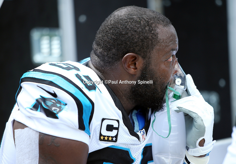 Carolina Panthers defensive end Charles Johnson (95) takes oxygen on the sideline during the 2015 NFL week 2 regular season football game against the Houston Texans on Sunday, Sept. 20, 2015 in Charlotte, N.C. The Panthers won the game 24-17. (©Paul Anthony Spinelli)