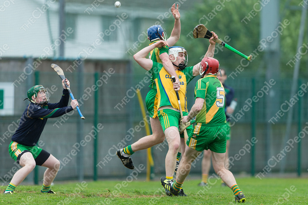 Inagh/Kilnamona's Gerry Coote and O'Callaghan's Mills Conor Cooney & Bryan Donnelan jump for the dropping ball
