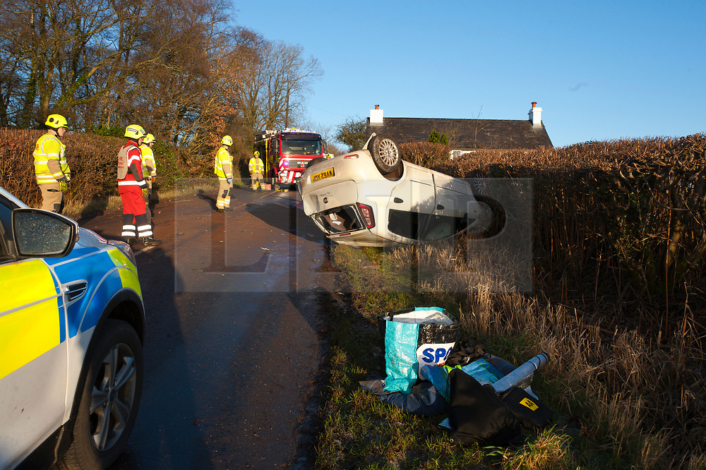 © Licensed to London News Pictures. 17/01/2019. Upper Chapel, Powys, Wales, UK. A car overturns on the B4520 road (Brecon Road) on high land near Upper Chapel in Powys, Wales, UK. The driver of the overturned vehicle reportedly escaped with just a scratch to the back of the hand. A motorist at the accident scene remarked that the roads had not been gritted.  Rain and sleet  and snow fell on high land in Powys, Wales, and the roads were treacherous in parts. credit: Graham M. Lawrence/LNP