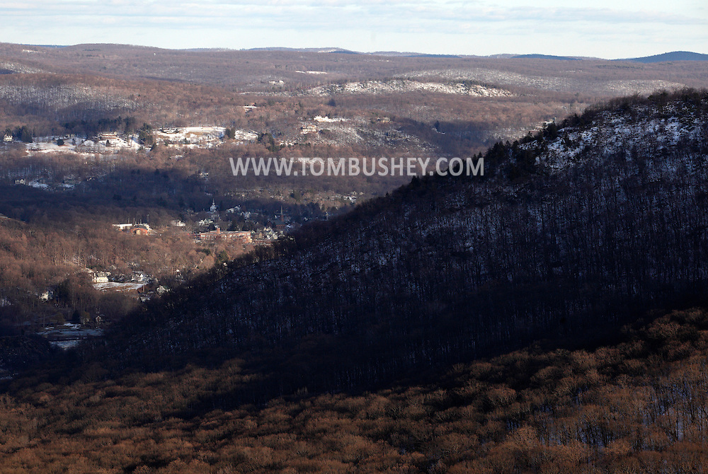 Cornwall, New York - A view of the Hudson Highlands on the west side, foreground, and east side of the Hudson River from Butter Hill in Storm King State Park on Feb. 20, 2010. Buildings in the village of Cold Spring is visible to the left side of the frame.