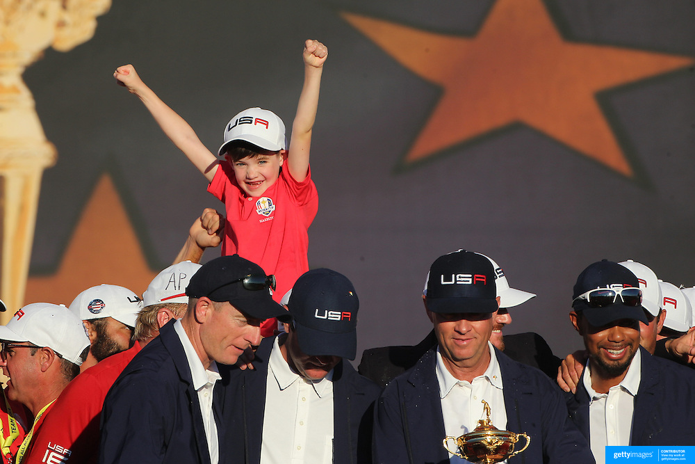Ryder Cup 2016. Day Three. The United States players and family members celebrate victory after the trophy presentation at the Ryder Cup tournament at Hazeltine National Golf Club on October 02, 2016 in Chaska, Minnesota.  (Photo by Tim Clayton/Corbis via Getty Images)