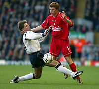 Fotball: Liverpool John Arne Riise and Bolton Wanderers Nicky Southall during the Premiership match at Anfield, London. Tuesday 1st January 2002.<br />