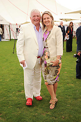 CHRISTOPHER BIGGINS and CARLA BAMBERGER at the Cartier International Polo at Guards Polo Club, Windsor Great Park, Berkshire on 25th July 2010.