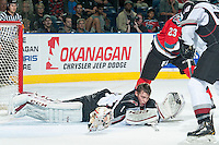 KELOWNA, CANADA - OCTOBER 1: Payton Lee #1 of Vancouver Giants loses his helmet in a scuffle in front of the net against the Kelowna Rockets on October 1, 2014 at Prospera Place in Kelowna, British Columbia, Canada.   (Photo by Marissa Baecker/Shoot the Breeze)  *** Local Caption *** Payton Lee;