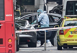 © Licensed to London News Pictures. 07/10/2017. London, UK. A police forensics officer looks into the passenger seat of a vehicle thought to have been driven into pedestrians in an incident is seen outside the Natural History Museum. Early reports say a man has been arrested after pedestrians injured. Photo credit: Peter Macdiarmid/LNP