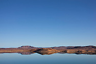 El-Mansour Eddabbi dam with mountains and reflections, Ouarzazate.