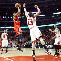 10 May 2011: Atlanta Hawks center Al Horford (15) takes a jump shot over Chicago Bulls center Joakim Noah (13) during the Chicago Bulls 95-83 victory over the Atlanta Hawks, during game 5 of the Eastern Conference semi finals at the United Center, Chicago, Illinois, USA.