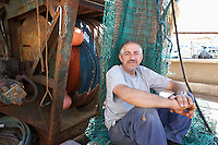 Fisherman on Boat by Fishing Net